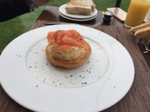 scrambled egg and salmon bagel