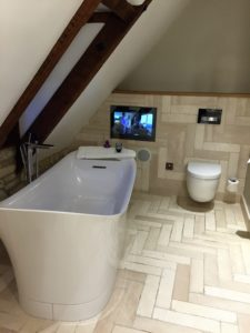 Our bathroom complete with TV
