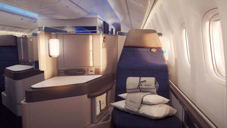 United's Polaris Business class seat with Saks bedding