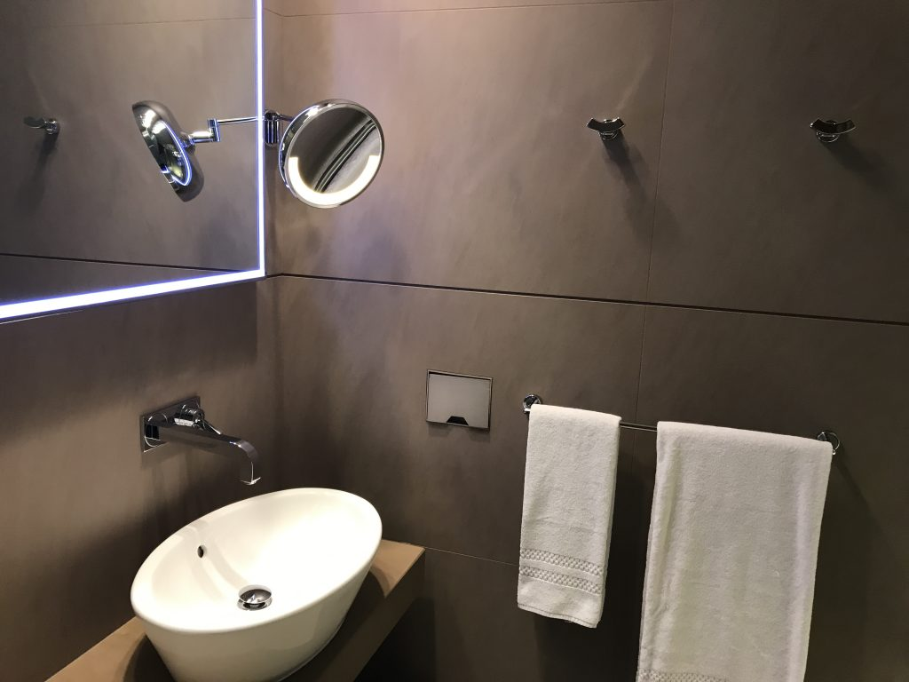 Qatar Airways Business Class Al Mourjan lounge Doha review shower room