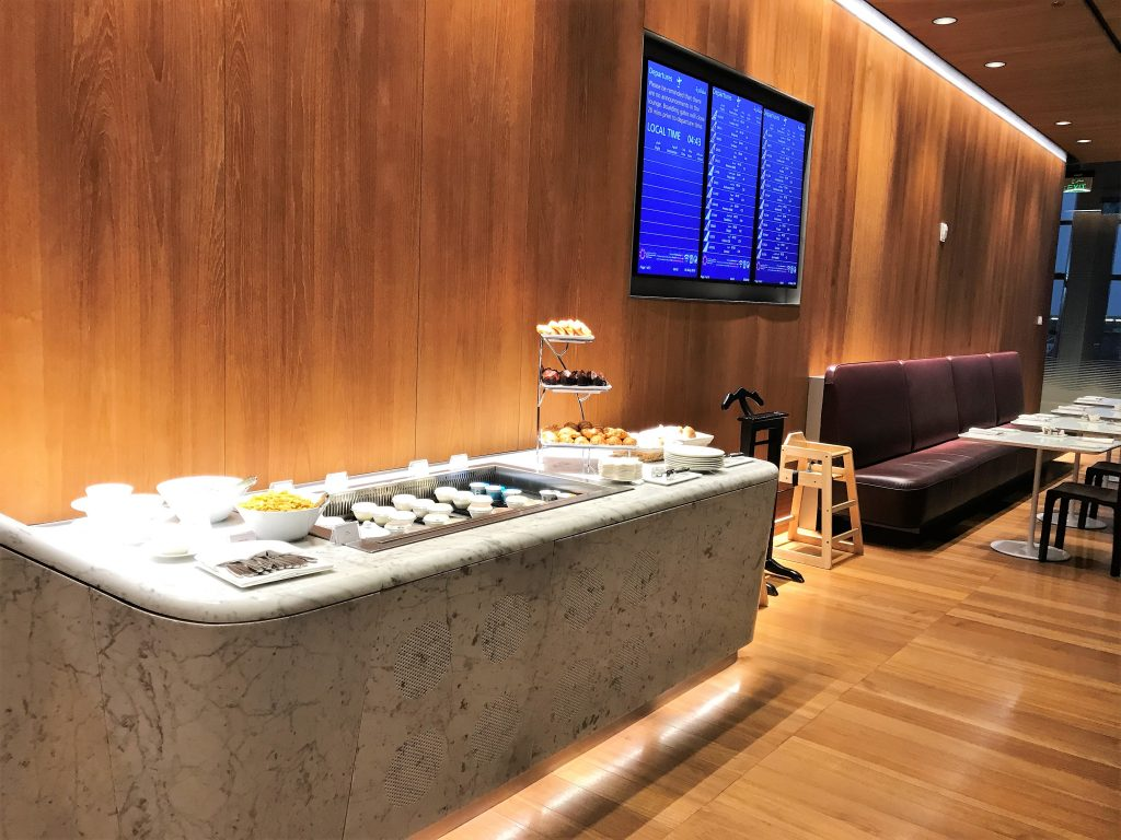 Qatar Airways Business Class Al Mourjan lounge Doha review back dining buffet
