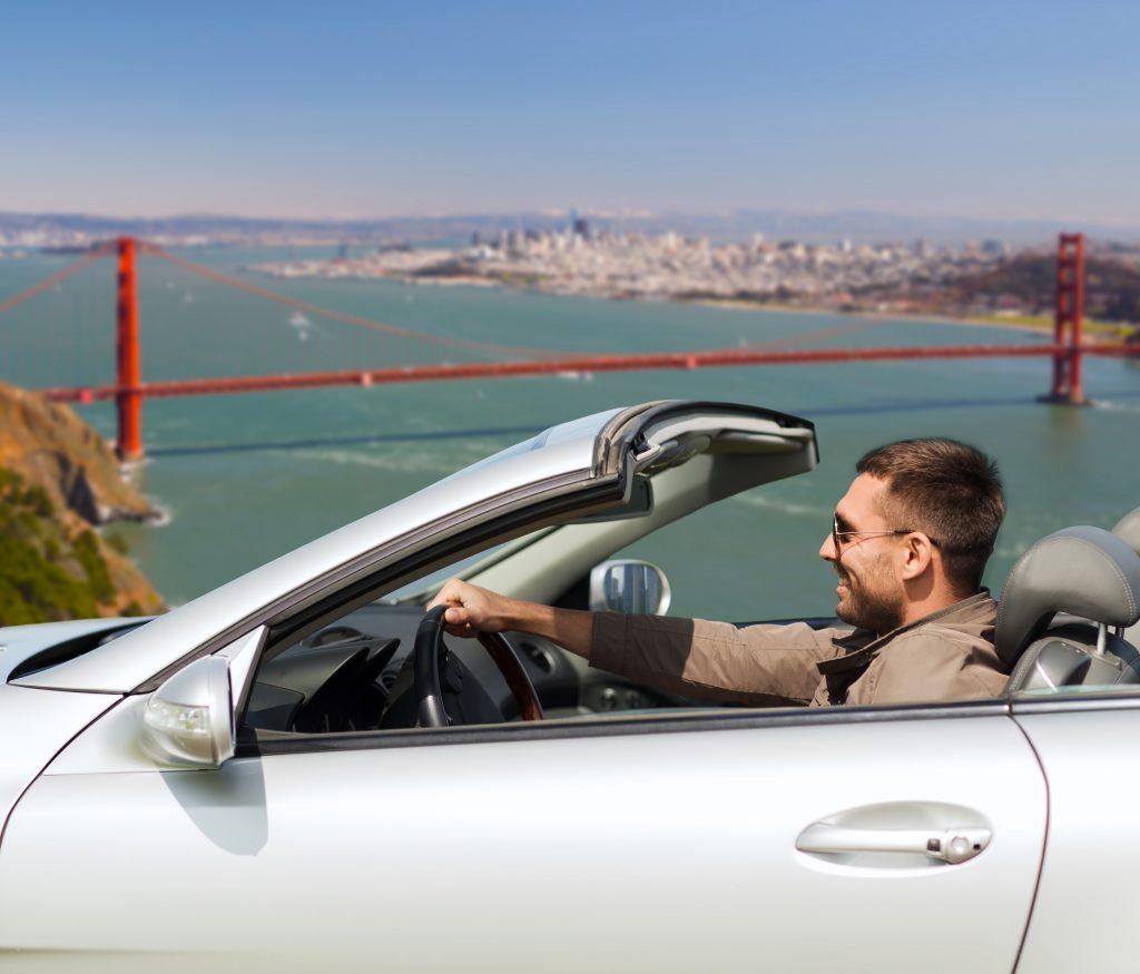A man navigating San Francisco in his car.
