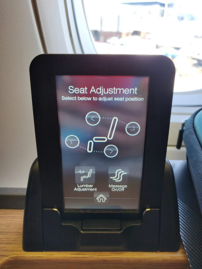 AA International First review seat controls