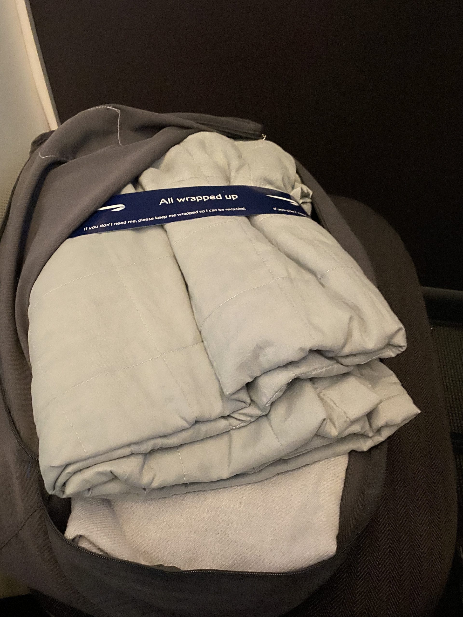 Club World White Company bedding with the day blanket at the top