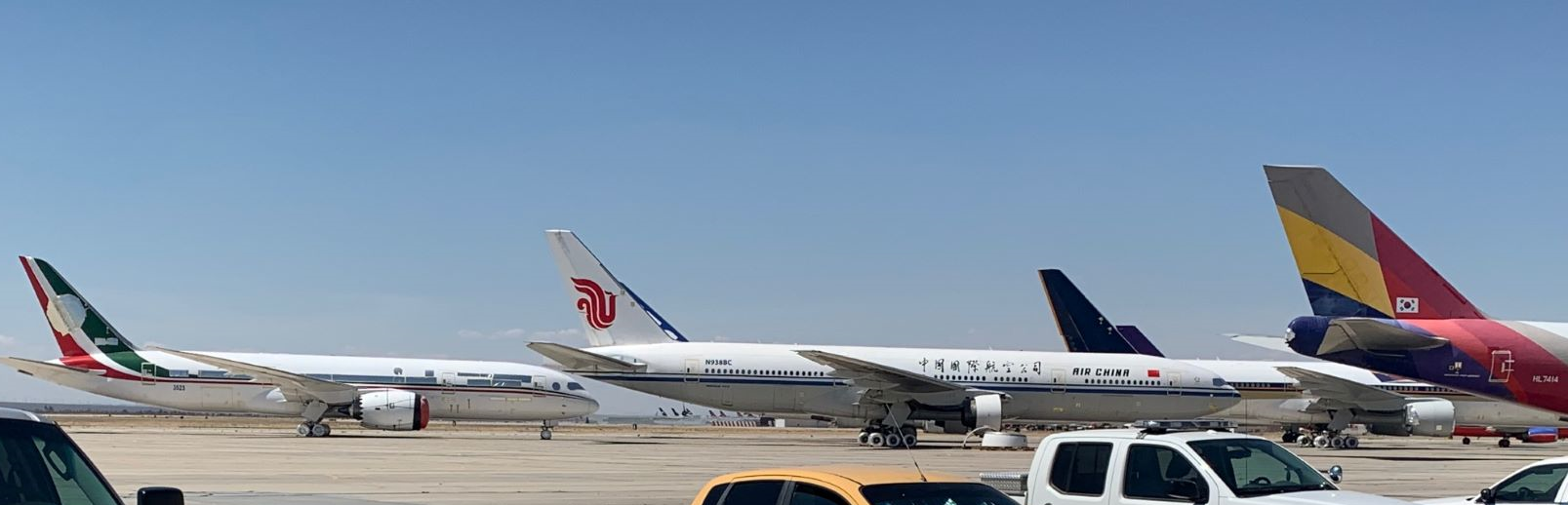 The ex Mexican Presidential Dreamliner is on the far left in red and green, along with 2 x ex Singapore Airlines 777's and an Asiana 747 Freighter