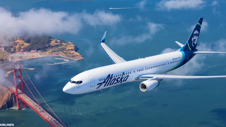 Alaska Airlines aircraft flying over a body of water.