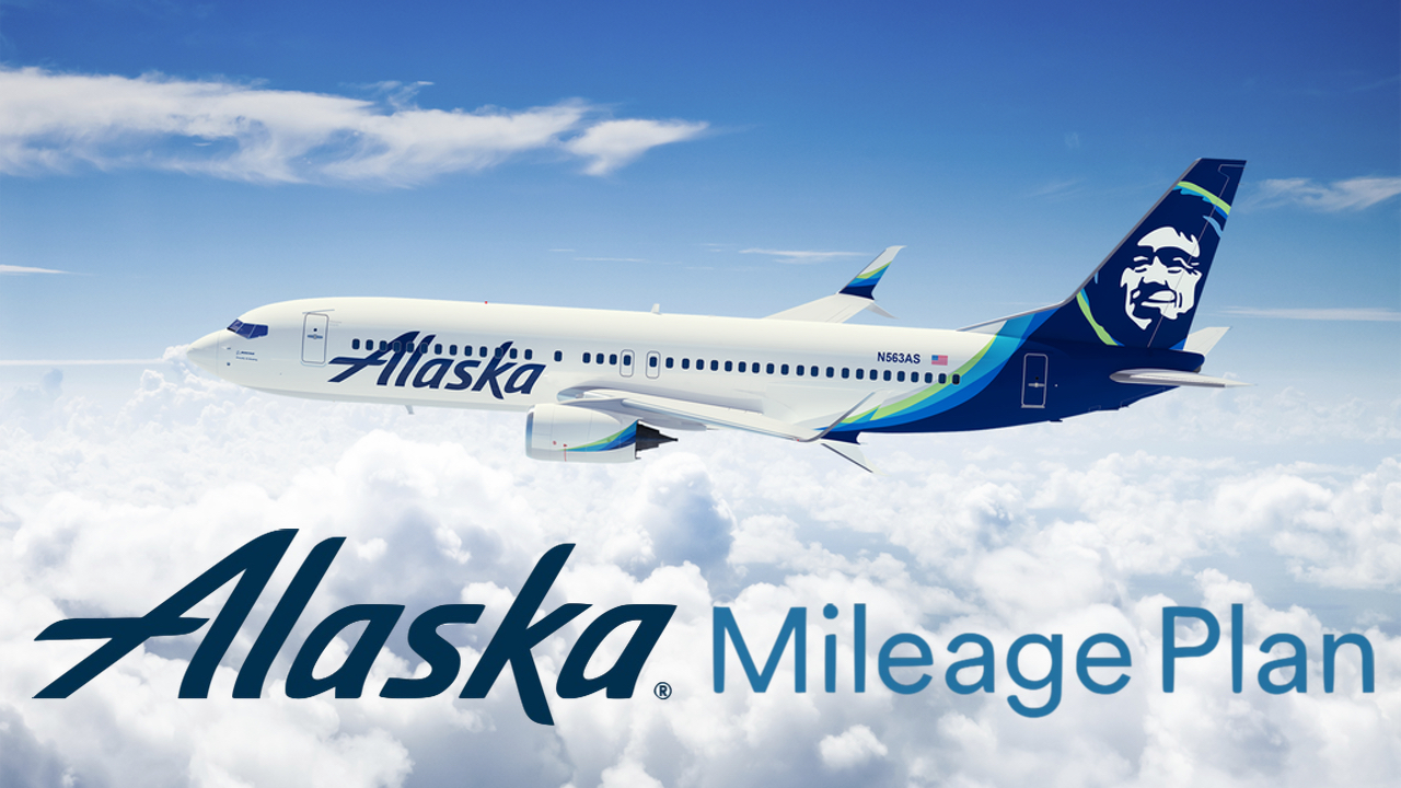 Alaska Airlines aircraft flying above clouds with the text Alaska Mileage.