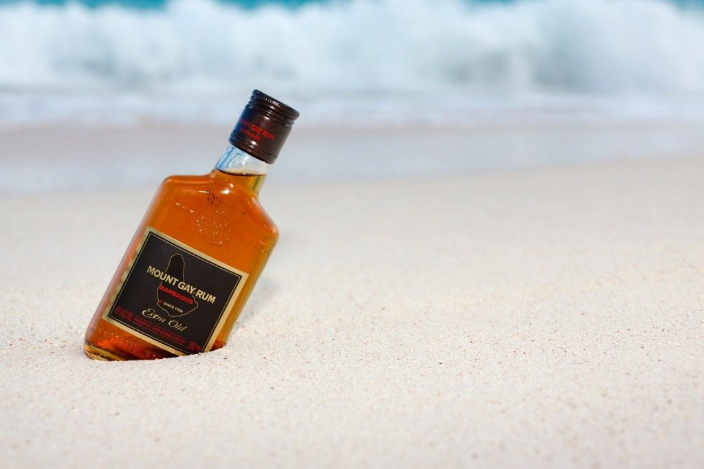 Mount Gray Rum distilled in Barbados on a beach.