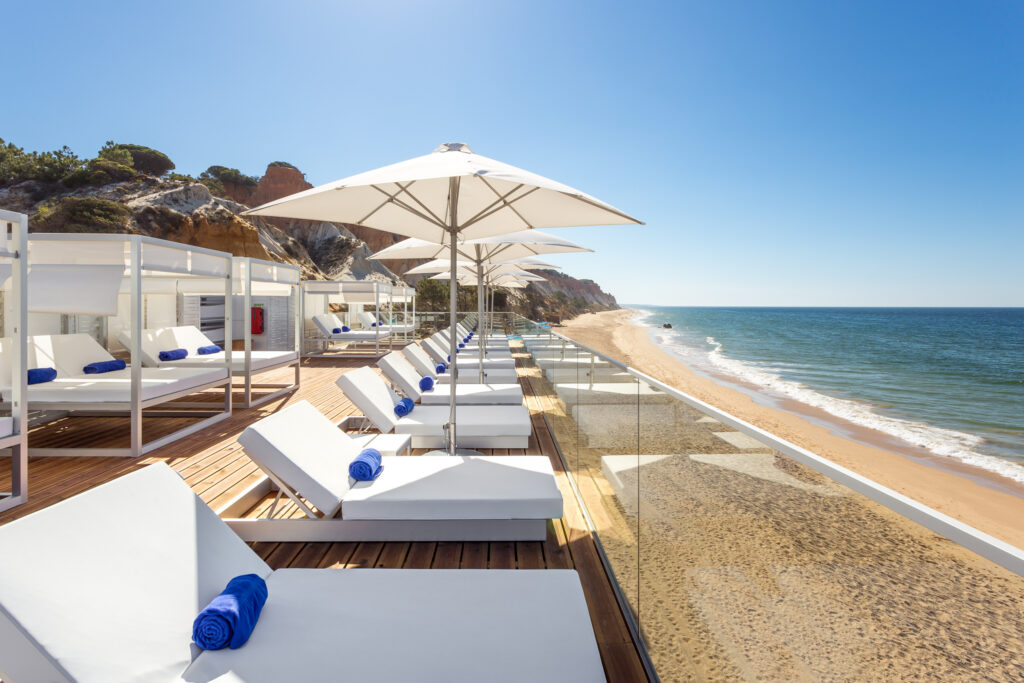 Beach at the Pines Resort with daybeds